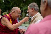Заместитель ректора исламского университета Джамия Миллия Наджиб Джунг встречает Его Святейшество Далай-ламу. Дели, Индия. 12 сентября 2012 г. Фото: Тензин Чойджор (Офис ЕСДЛ)