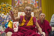 """Его Святейшество Далай-лама во время публичной лекции в зале """"Форум Модильяни"""". Ливорно, Италия. 15 июня 2014 г. Фото: FilmPRO."""