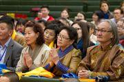 Монгольские буддисты на встрече с Его Святейшеством Далай-ламой в первый день его учений в университете Шова. Токио, Япония. 12 апреля 2015 г. Фото: Тензин Джигме