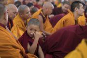 Юный монах во время посвящения одиночного Ямантаки, даруемого Его Святейшеством Далай-ламой. Бодхгая, штат Бихар, Индия. 21 января 2018 г. Фото: Лобсанг Церинг.